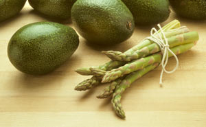 Asparagus and avocados are healthy early spring foods.